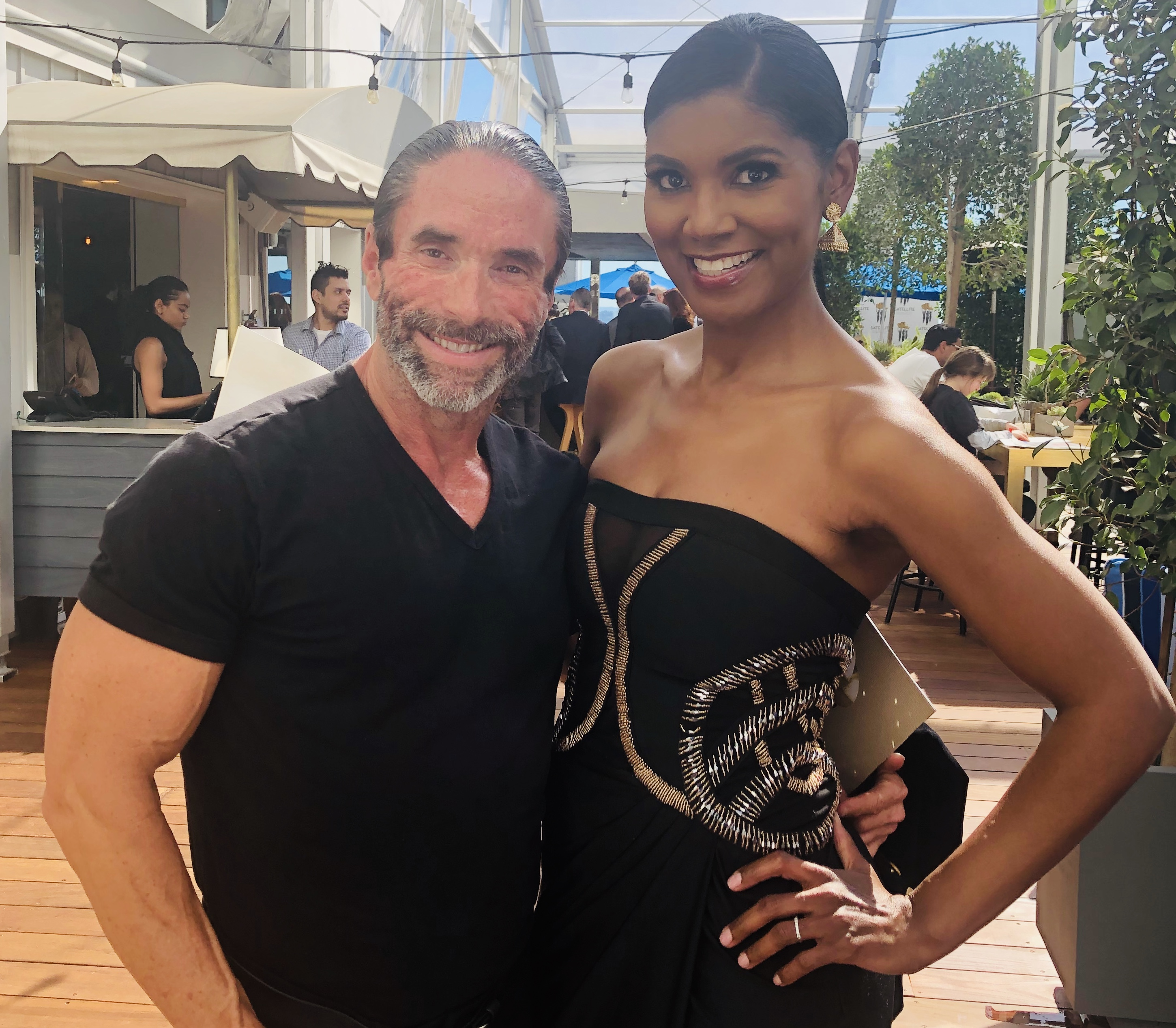 Jasper Cole and Actress Denise Boutte presenting at The Satellite Awards